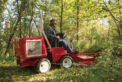 Ventrac 3400Y using the LQ450 Mower - Two counter-rotating blades discharge the cut grass to the center rear.