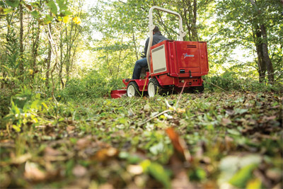 Ventrac 3400 Clearing a path with the Field Mower - The Field Mower tackles thick brush and overgrown vegetation and leaves behind an even cut clearing.