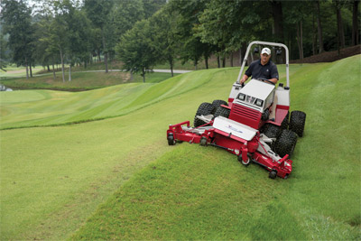 Ventrac 4500 Mowing Golf Course with Contour Deck - The MJ840 features full rear rollers for even cutting and striping, rear discharge, and a flip-up deck design.