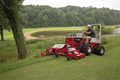 Ventrac 4500Z using Contour Mower - Three decks float independently and follow the contour of the terrain with up to 40 degrees of motion for each side deck. The MJ840 also features full rear rollers for even cutting and striping, rear discharge, and a flip-up deck design.