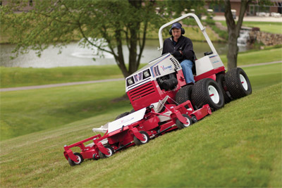 Ventrac 4500P mowing with Contour Mower - Optional dual turf tires adds maximum traction with minimum turf damage.