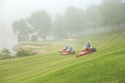 Trio of Ventrac 4500s Work in the Early Morning Fog - The high-quality build of the Contour Mower means seamless stripes even with multiple mowers.