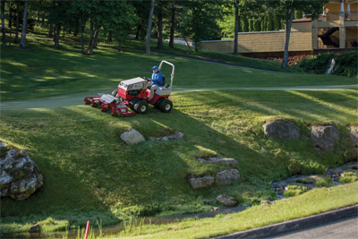 Ventrac 4500 with Dual Wheels using Contour Mower - The Ventrac 4500 with Dual Wheels can maneuver where other tractors are unable to safely go.