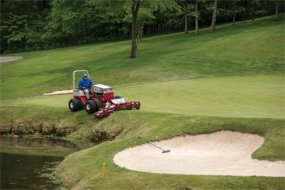 Ventrac 4500 with Dual Wheels using Contour Mower on Golf Course - Try to precision mow golf course turf next to a lake, on a slope, and near sand traps with a straight frame economy tractor. It can't be done safely, if it all.