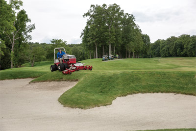 Ventrac 4500 with Contour Deck Skirts Sand Trap at Golf Course - Maneuver more easily around obstacles like sand traps at golf courses with the Ventrac 4500 and the Contour Mower.