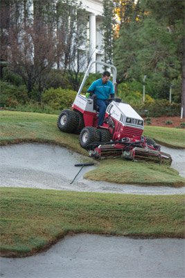 Ventrac 4500 with Reel Mower Finish Mowing Golf Course - Shown with optional dual wheels the AWD 4500 can maneuver more places and, together with the front-mounted Reel Mower, can reduce the amount of hand work needed to maintain professional turf areas.