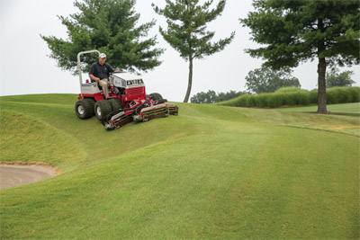 Ventrac 4500 with Dual Wheels and MR740 Reel Mower - The reels can be offset right and left of center to allow for better trimming around tight turns, and to position the tractor farther from hazards such as water or bunkers for increased safety.