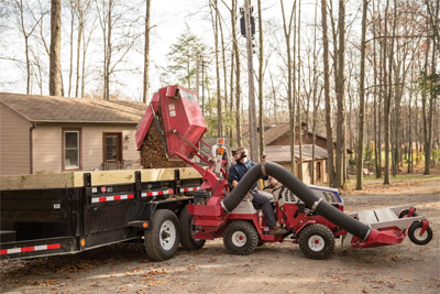 Ventrac 4500 Dumping Leaves from the Vacuum System Bin - Using hydraulic lift, the RV602 is capable of lifting a full bin to five feet for easy dumping of materials into a variety of trailers.