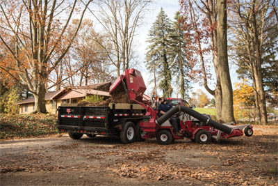 Ventrac 4500 Dumping Leaves from the Vacuum System Bin - Easily lift the collection bin five feet in seconds to empty it and back in position to get underway again.