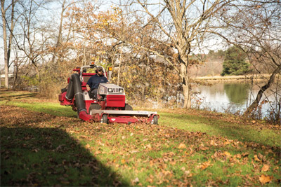 Ventrac 4500 Fighting Fall Leaves with the RV602 - The Ventrac 4500 along with Vacuum Collection System can remove even thick blankets of leaves from various types of turf.