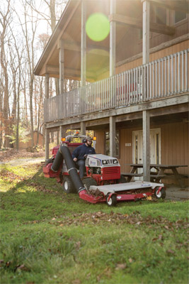 Ventrac 4500 Collecting Leaves in Fall - The vacuum system even works on slopes thanks to Ventrac's industry leading slope ratings.