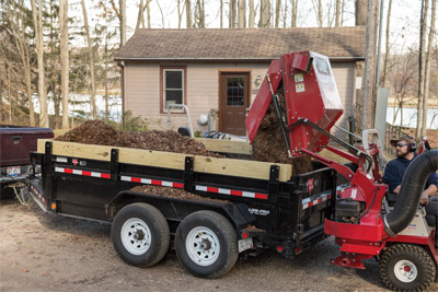 Filling a Trailer with the Ventrac RV602 - Hydraulic lift and long reach makes it easy to drop 16 cubic feet of materials into any trailer or truck bed.