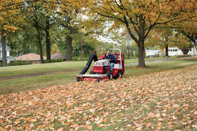 Ventrac 4500 Collecting Leaves using RV602 Vacuum - First the mowing deck shreds leaves and then the smaller particles are pulled into the large, rear-mounted bin. This process allows for maximum use of storage space.