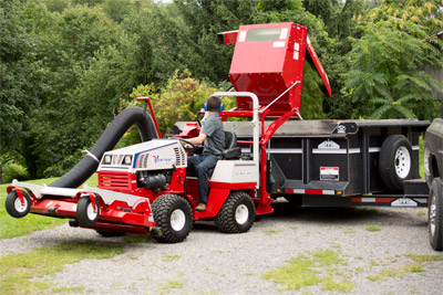 Ventrac 4500 Dumping Clippings from the Vacuum System Bin - The bin can be lifted five feet and has enough overhang to extend its reach over a truck or trailer.