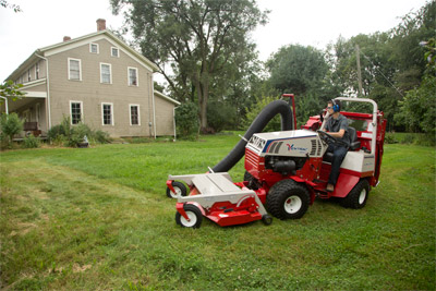 Ventrac 4500Y Mowing and Sweeping - Even thicker, higher grass can be easily swept up by the RV602 Vacuum System
