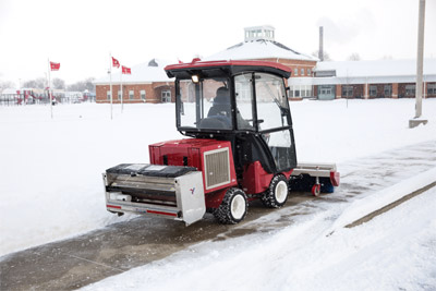 Ventrac 3400 Clearing Snow with Broom - The 3400 removes snow and delivers salt at the same time to save time.