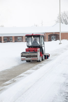 Ventrac 3400 Drops Salt using SA250 - The SA250 Spreader delivers salt precisely where you want it so as not to waste any.