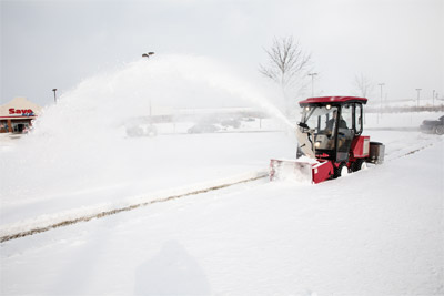 "Ventrac 3000 using LX423 Snowblower - A two stage snow blower, the LX423 features a 16"" diameter solid auger for best snow transfer, a large 20"" diameter fan , and the ability to move 2500 pounds of snow per minute at distances up to 40 feet."