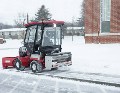 Ventrac 4500 Spreads Salt - Material is evenly distributed using a unique compression roller system. An easy gate adjustment allows for fine tuning flow rates based on the type of material being spread and the desired quantity being applied. The wireless remote control regulates five motor speeds for quick flow adjustments from the operator seat.