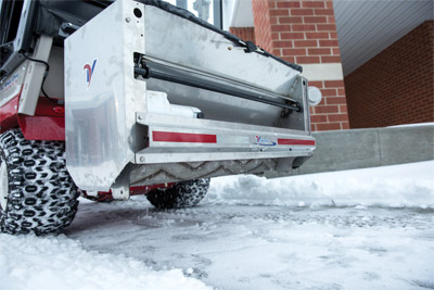 "Ventrac SA250 Drop Spreader - The Ventrac Sidewalk Drop Spreader is the ultimate tool for spreading an array of deicing materials with precision flow control. Designed with a narrow frame and a 40"" drop pattern, this spreader is ideal for spreading material on sidewalks and other narrow walkways."