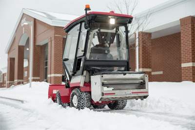 Ventrac 4500 using SA250 Spreader on Sidewalks - Shown with the enclosed heated cab.
