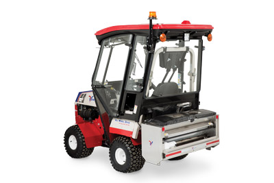 Ventrac 4500 Rear View with Snow Setup - Shown with fully enclosed cab and SA250 Drop Spreader.