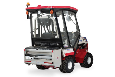 Ventrac 4500 Rear View with Snow Setup right side - Shown with fully enclosed cab and SA250 Drop Spreader.