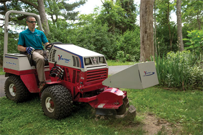 Ventrac 4500Z with KC180 Stump Grinder - Heavy-duty carbide tips line the grinding wheel to cut through even hardwood stumps.